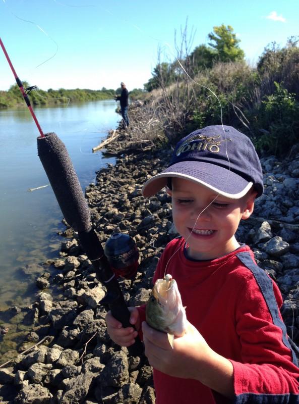 Young boy in baseball cap, fishing